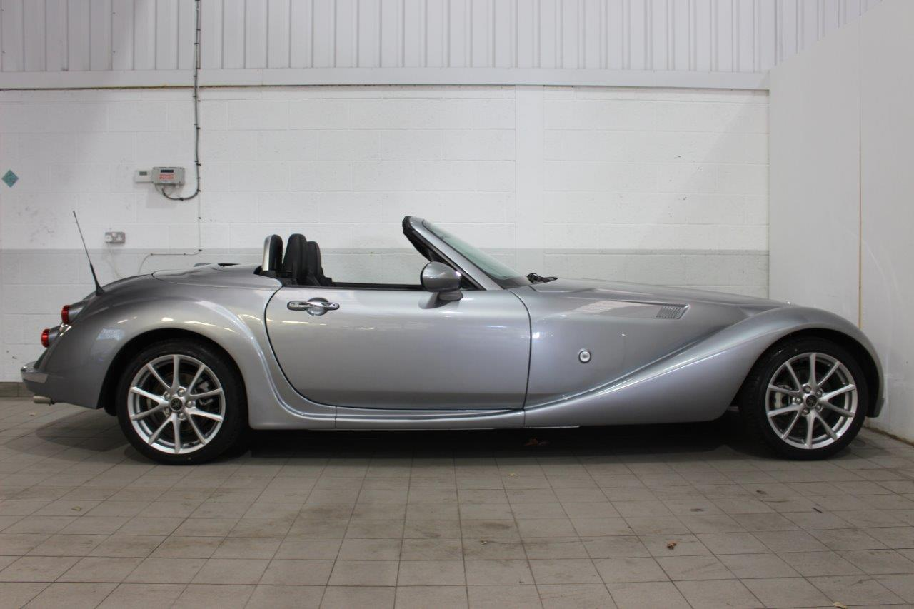 mitsuoka roadster roof down side
